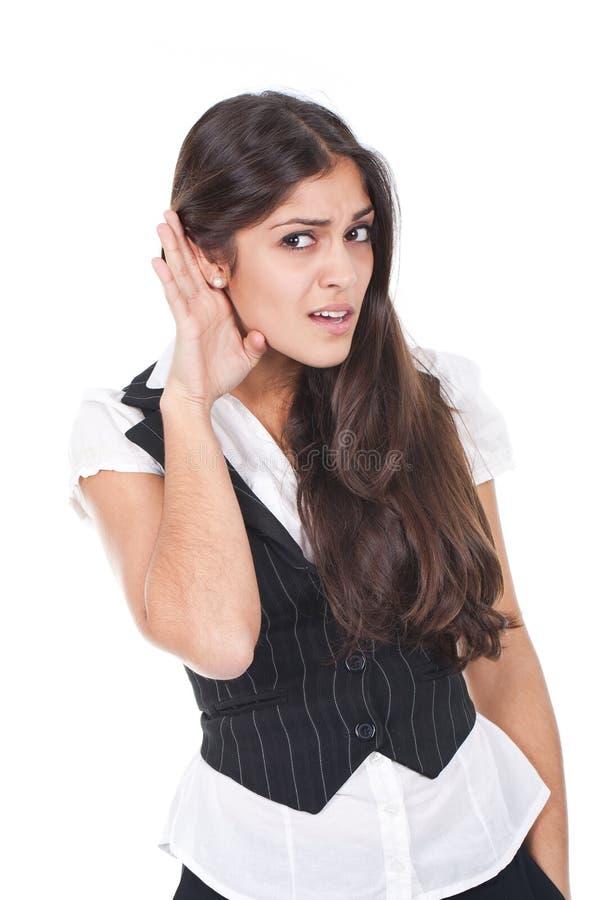 Frauenhören lizenzfreies stockfoto