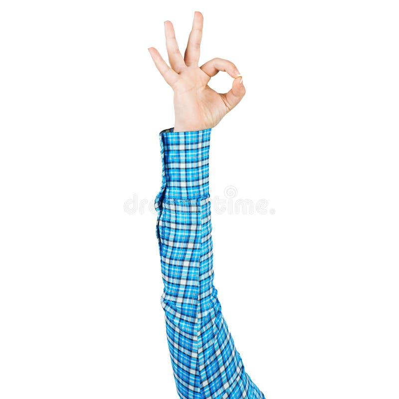 Frauenhand in blauem kariertem Hemdvertretung O.K. lizenzfreie stockfotografie