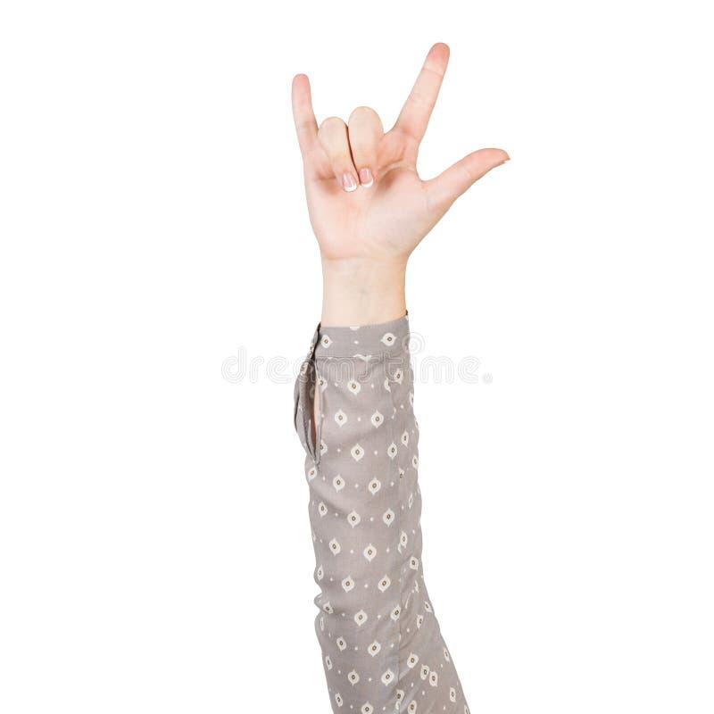 Frauenhand in den grauen Blusenvertretungs-Teufelhörnern lizenzfreie stockbilder