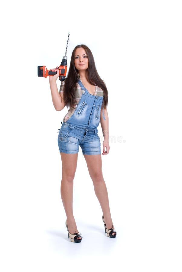 Frauenholding-Batteriebohrgerät lizenzfreie stockbilder