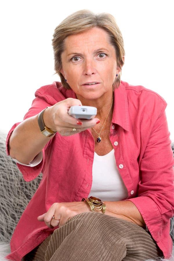 Frauenholding Fernsteuerungs stockbilder