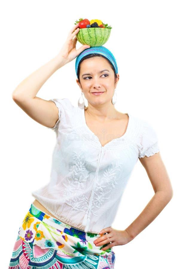 Frauenholding-Fruchtschüssel obenliegend lizenzfreies stockbild