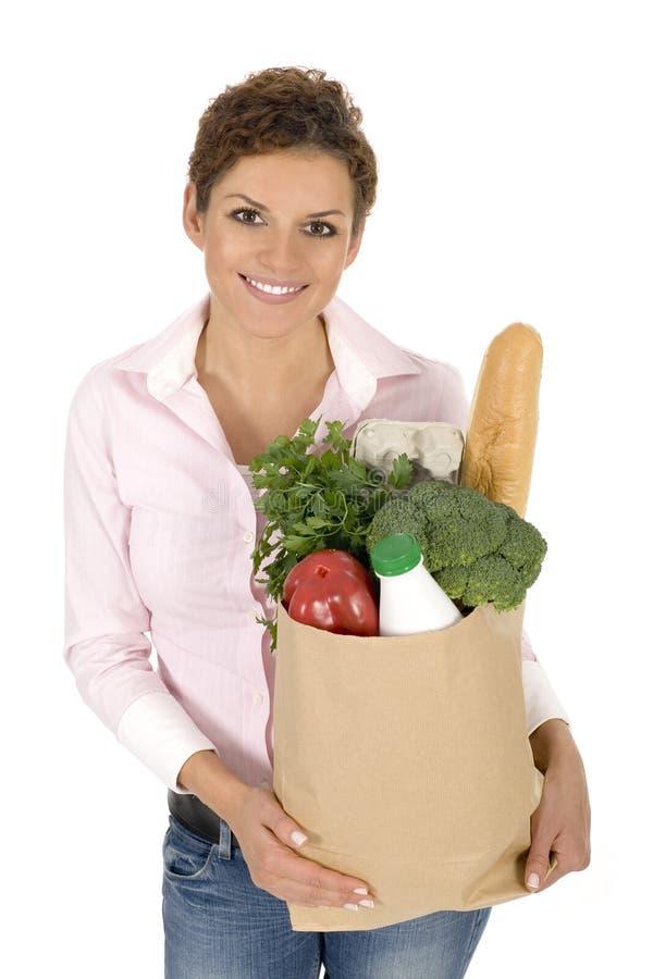 Frauenholding-Lebensmittelgeschäftbeutel stockbilder