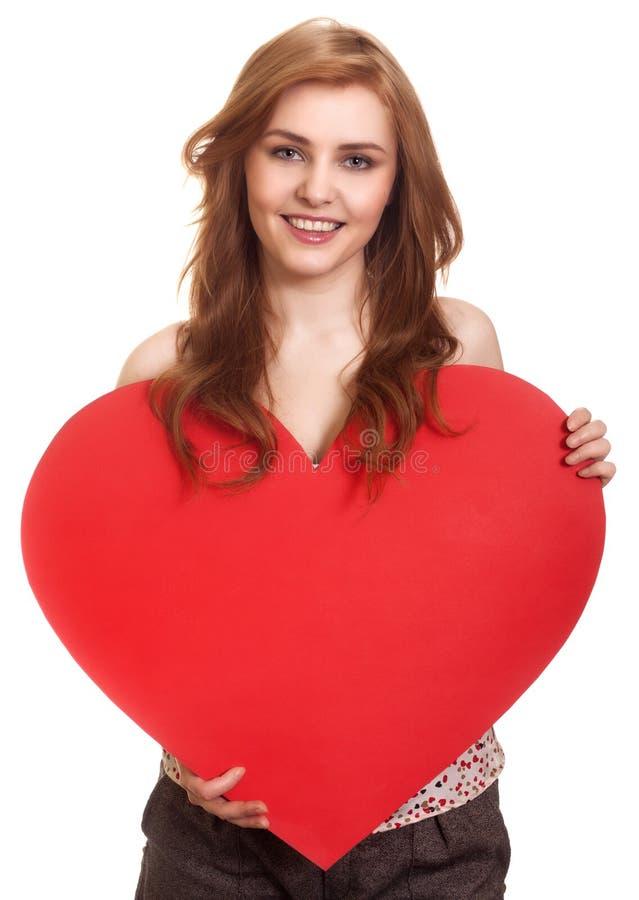 Frauenholding Valentinsgruß-Tagesinneres lizenzfreies stockfoto
