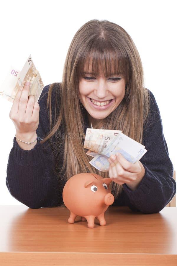 Frauenholdinggeld stockfotos