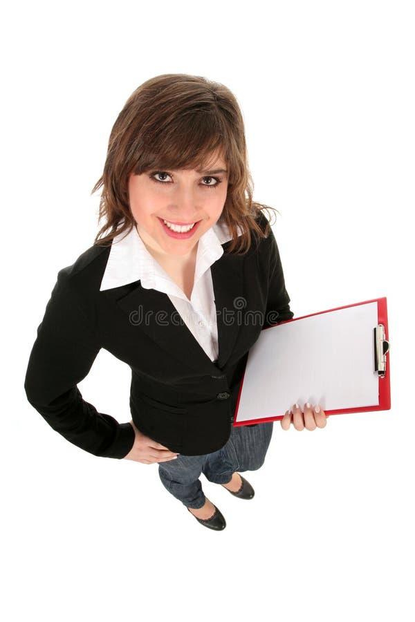 Frauenholdingklemmbrett lizenzfreie stockbilder
