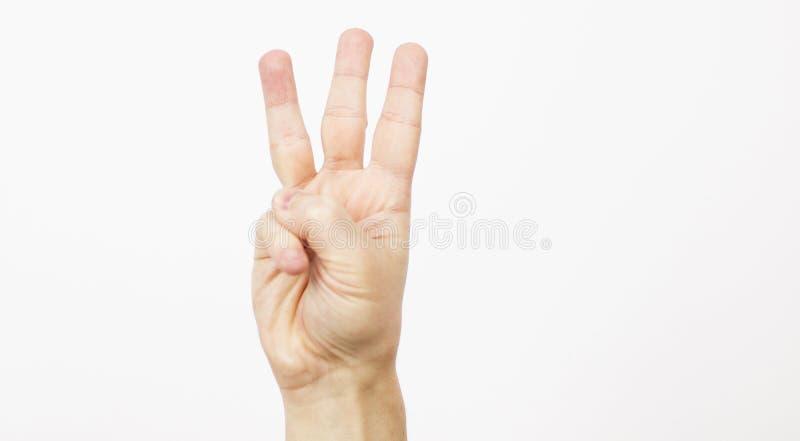 Frauenmannhände zeigen die Nr. drei auf einem weißen Hintergrund Perfektes Bild für Geschäft Drei Daumen Männliche Hand ist stockfoto