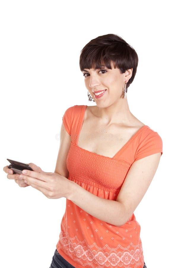 Frauenorangentelefon stockfoto