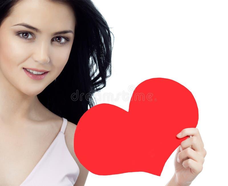 Frauenschönheit mit roter Herzvalentinsgruß ` s Liebe stockfotos
