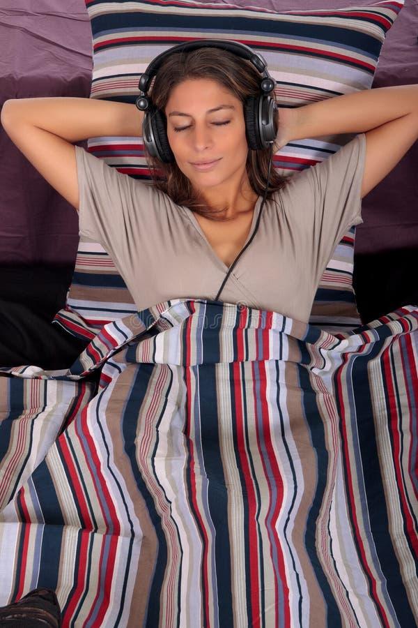 Frauenschlafzimmermusik lizenzfreie stockfotografie