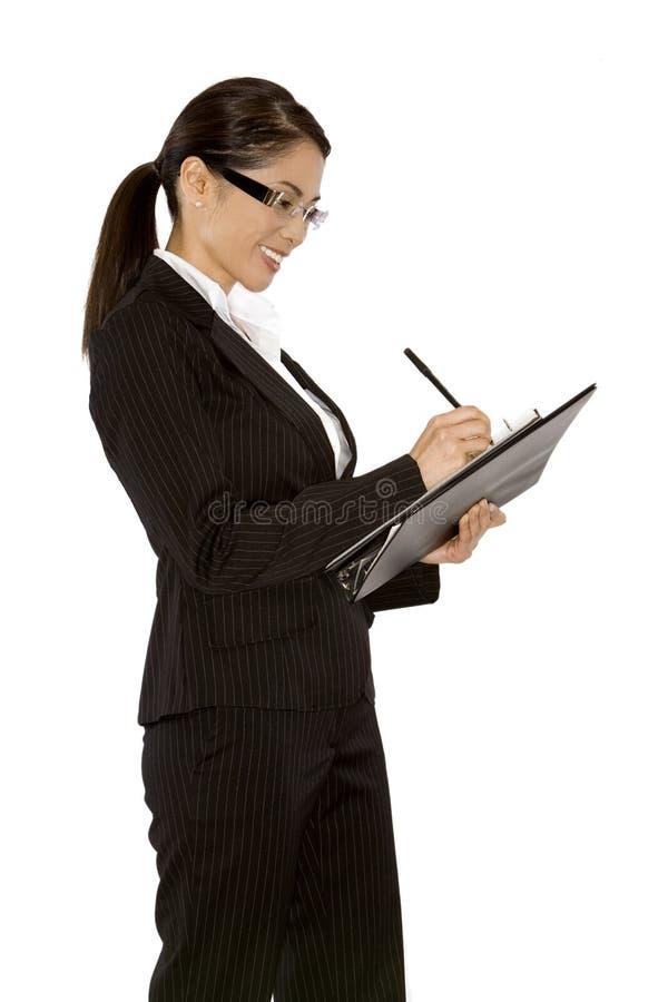 Frauenschreibensanmerkungen stockbild