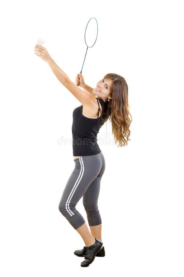 Frauenspieler mit dem Federballschläger, der Ball hält stockfotografie