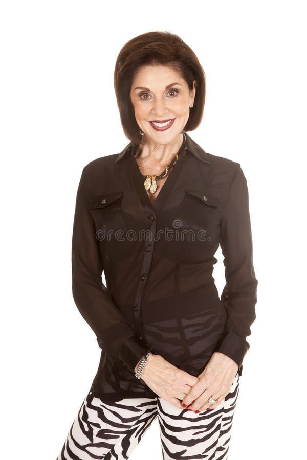 Frauenzebra-Hosenhände lächeln unten stockbilder