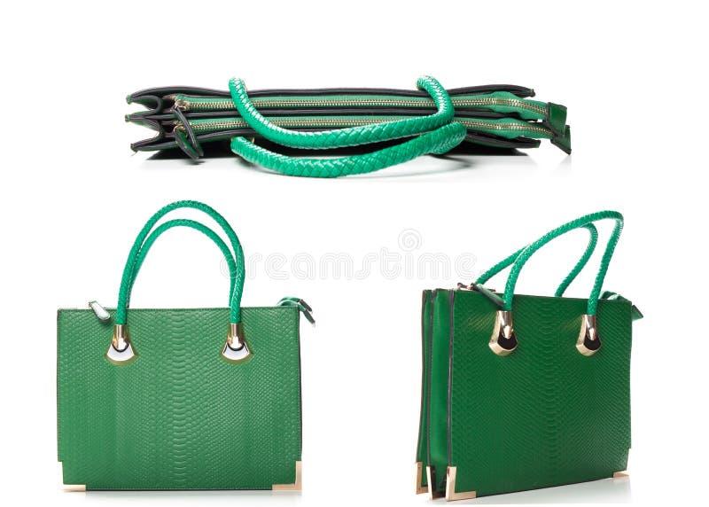 Frauenzusatz - stilvolle Tasche lokalisiert auf weißem, grünem Leder wo stockfotografie