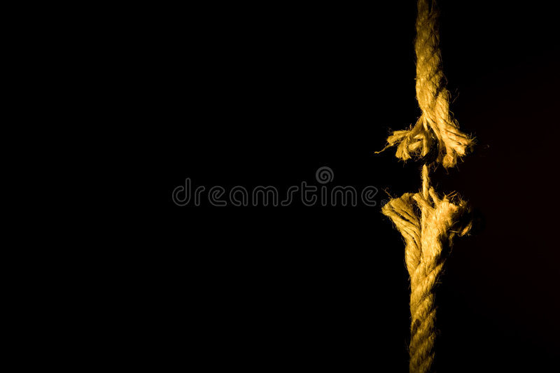 Frayed rope breaking stock photos