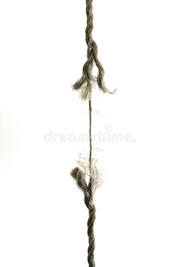 Frayed rope about to break. A hanging rope is about to break stock image