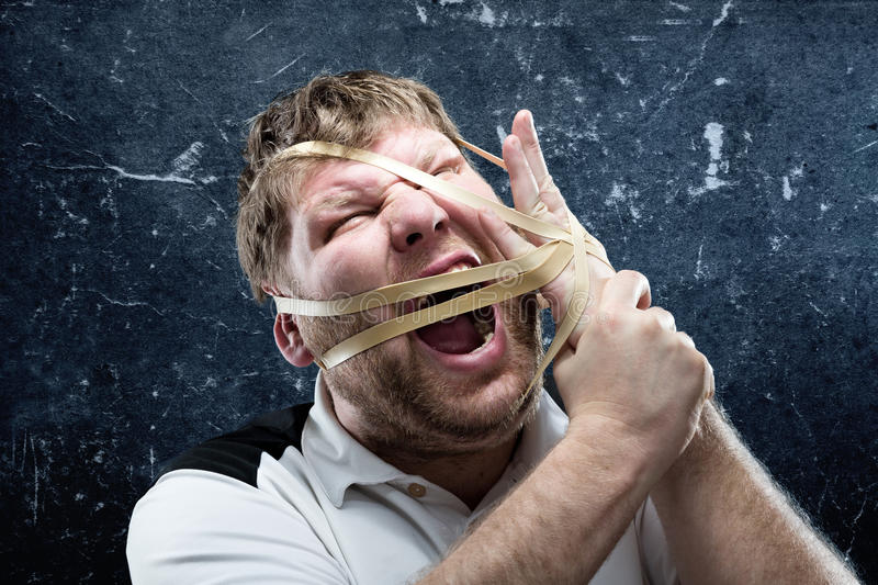 Freak man with rubber on his face. And hand royalty free stock image
