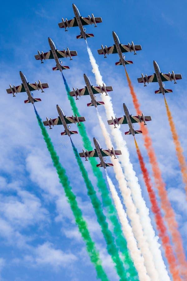 Frecce tricolore. The italian acrobatic jet squad named frecce tricolori doing tricks in the sky stock photos