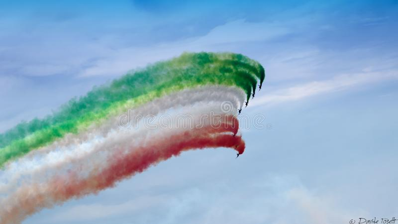 Frecce Tricolore in the sky. In the sky of Garda Lake in Sirmione , spectacular, flag, airplane, background, storm, acrobatic flock, summer, blue sky, flag stock photography