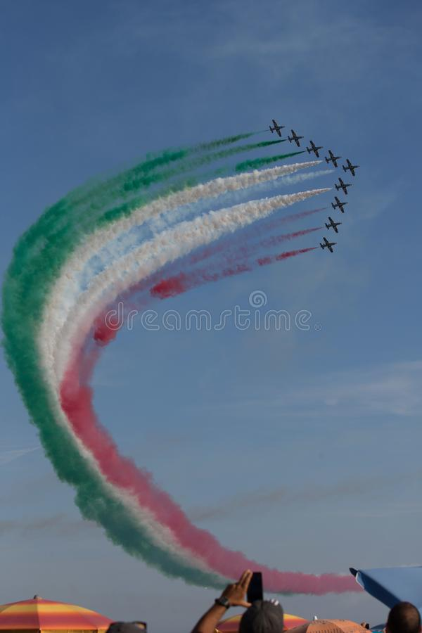 Frecce Tricolore, Three-Colored Arrows in Ladispoli, Italy. The Frecce Tricolore, the Three-Colored Arrows, fly all over Italy for celebrations, this one to stock photography