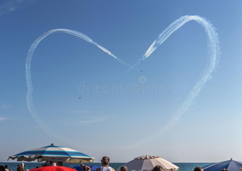 Frecce Tricolore, Three-Colored Arrows in Ladispoli, Italy. The Frecce Tricolore, the Three-Colored Arrows, fly all over Italy for celebrations, this one to stock image