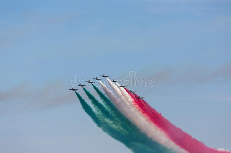 Frecce Tricolore, Three-Colored Arrows in Ladispoli, Italy. The Frecce Tricolore, the Three-Colored Arrows, fly all over Italy for celebrations, this one to royalty free stock images
