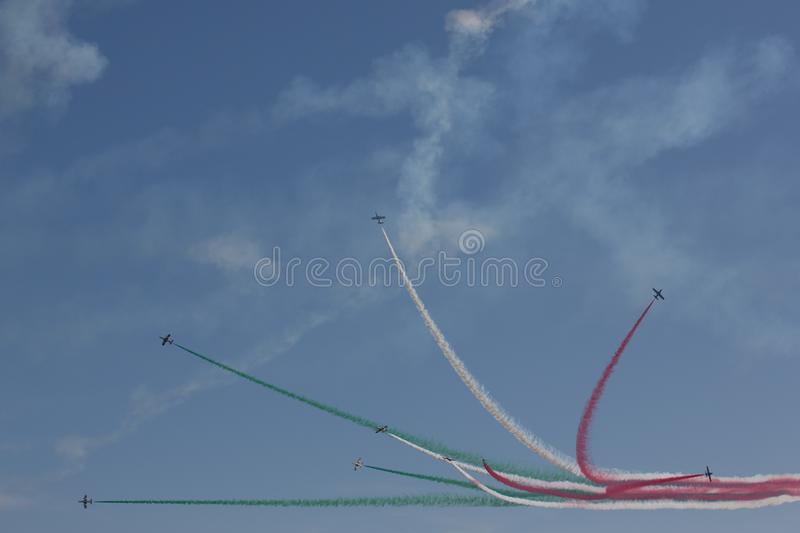 Frecce Tricolore, Three-Colored Arrows in Ladispoli, Italy. The Frecce Tricolore, the Three-Colored Arrows, fly all over Italy for celebrations, this one to royalty free stock photo