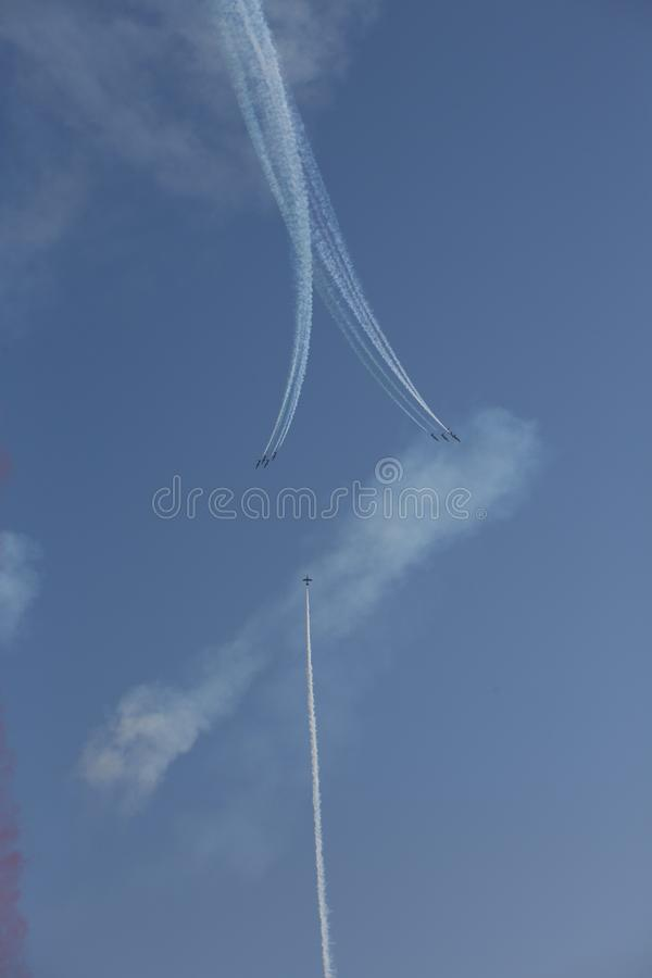 Frecce Tricolore, Three-Colored Arrows in Ladispoli, Italy. The Frecce Tricolore, the Three-Colored Arrows, fly all over Italy for celebrations, this one to royalty free stock image