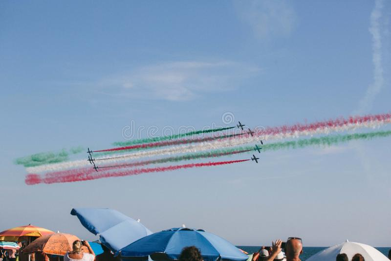 Frecce Tricolore, Three-Colored Arrows in Ladispoli, Italy. The Frecce Tricolore, the Three-Colored Arrows, fly all over Italy for celebrations, this one to stock photos