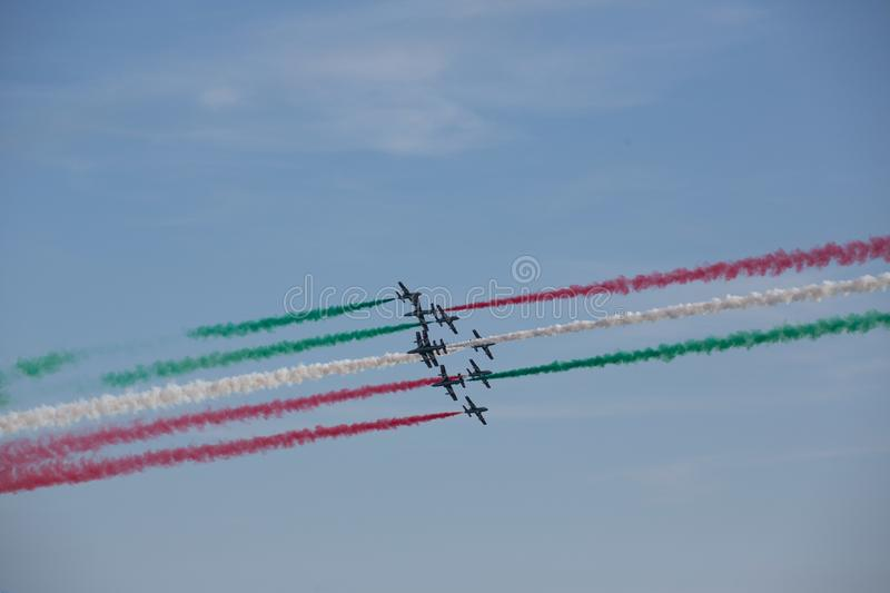 Frecce Tricolore, Three-Colored Arrows in Ladispoli, Italy. The Frecce Tricolore, the Three-Colored Arrows, fly all over Italy for celebrations, this one to stock images