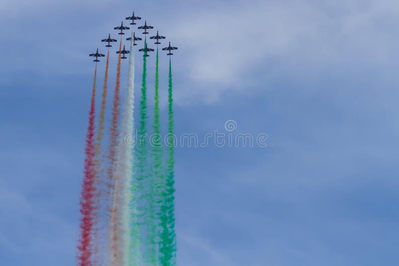 Frecce Tricolori: italian aerobatic Team drawing italian flag with color smoke. Frecce Tricolori: italian aerobatic Team drawing italian flag with colored smoke royalty free stock images