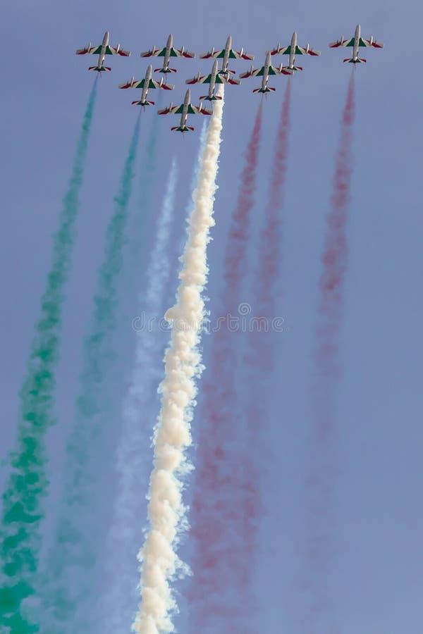 Frecce Tricolori: italian aerobatic Team drawing italian flag. With colored smoke royalty free stock photos