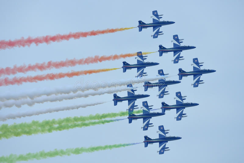 Frecce Tricolori Italian aerobatic team. On May, 1, 2015 over EXPO Fair site in Milan, Italy royalty free stock photos