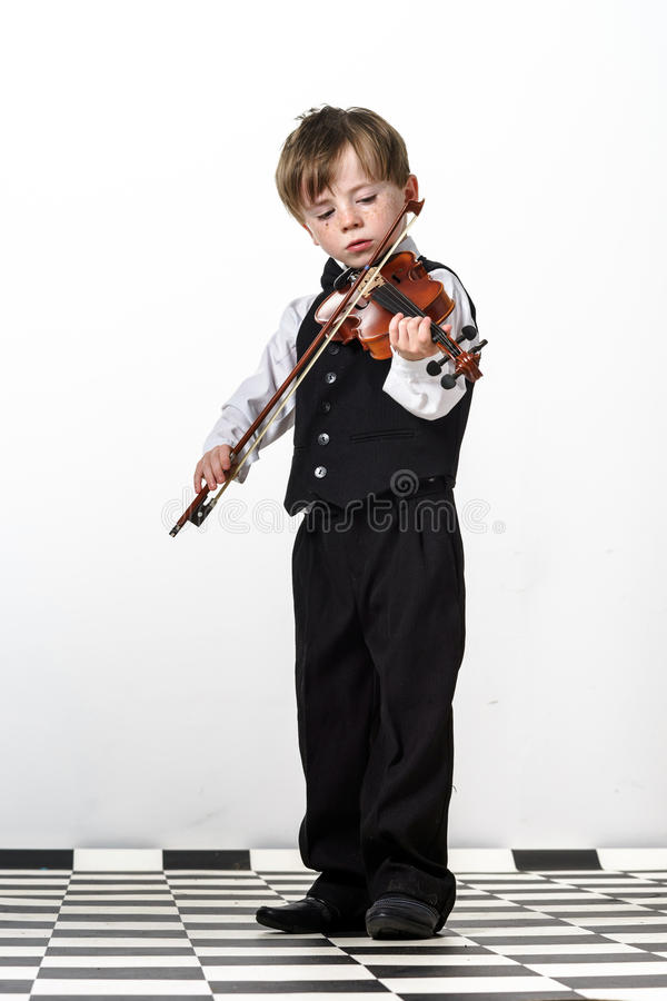 Free Freckled Red-hair Boy Playing Violin. Stock Photo - 32294980