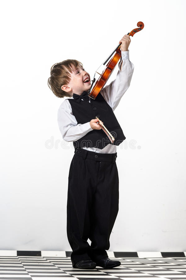 Free Freckled Red-hair Boy Playing Violin. Stock Photography - 32294982