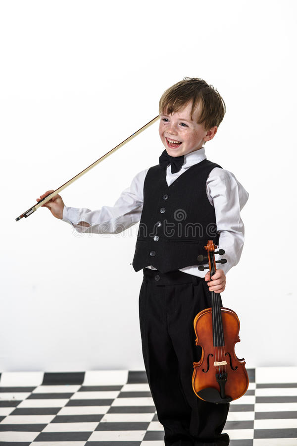 Free Freckled Red-hair Boy Playing Violin. Stock Photo - 32295000