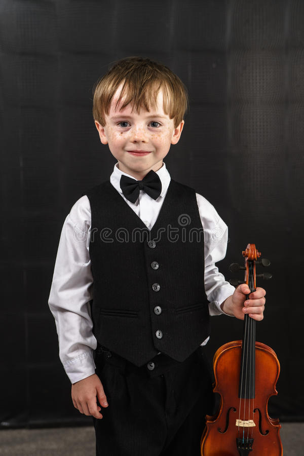 Free Freckled Red-hair Boy Playing Violin. Stock Images - 32295004