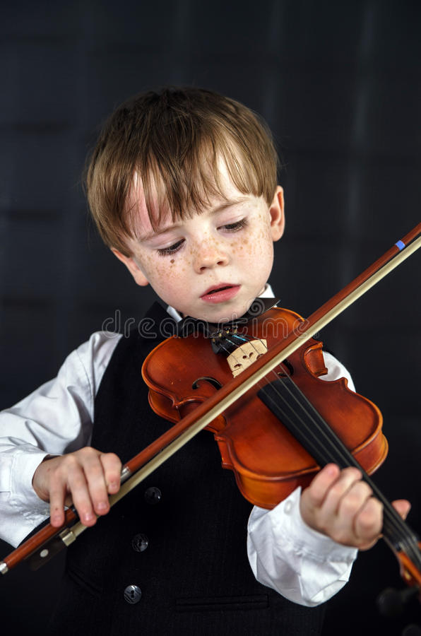 Free Freckled Red-hair Boy Playing Violin. Stock Image - 32295011
