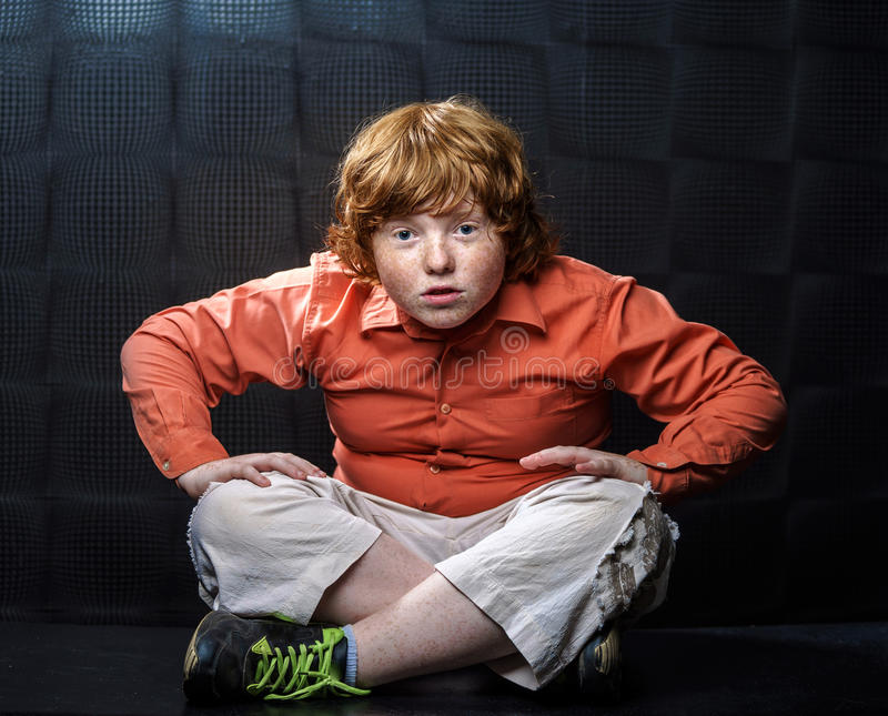 Download Freckled Red-hair Boy Posing On Dark Background. Stock Photography - Image: 32295092