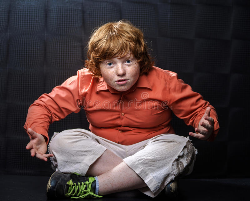 Download Freckled Red-hair Boy Posing On Dark Background. Stock Photo - Image: 32295094