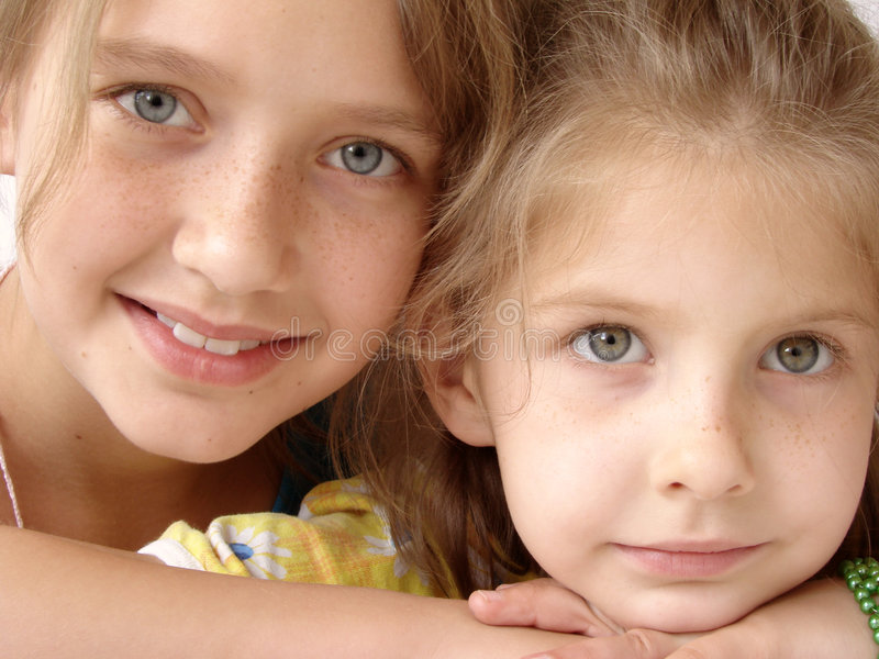 Freckly sisters stock image