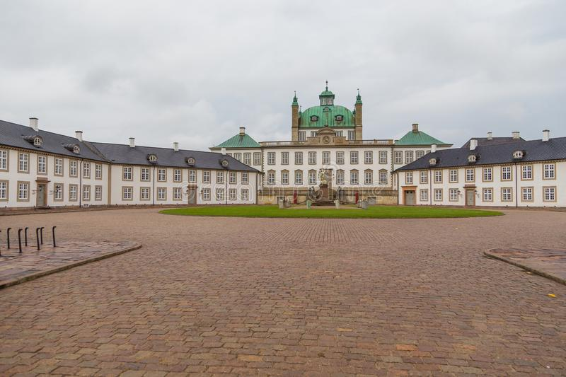 Fredensborg Palace, residences of the Danish Royal Family, Denmark. Fredensborg, Denmark- 30 August 2014: Fredensborg Palace, one of the official residences of stock images