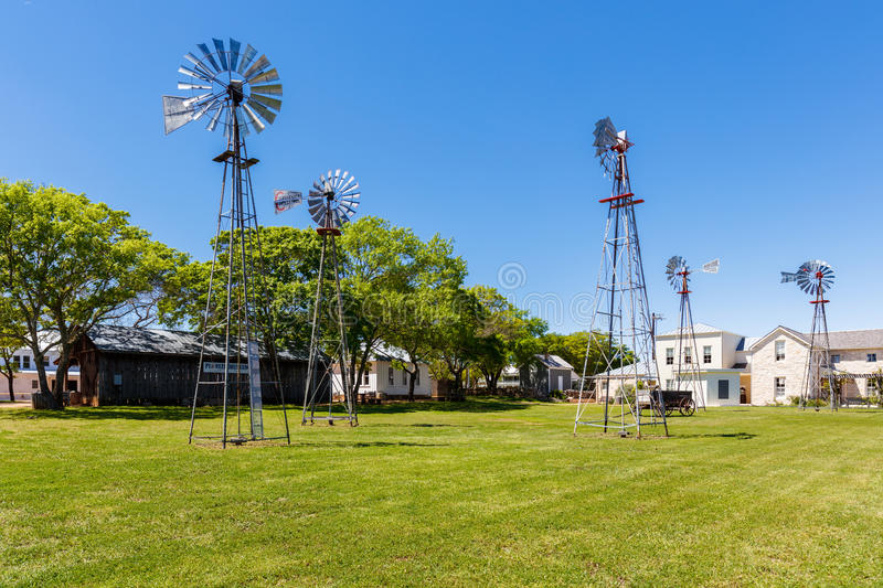 Fredericksburg Pioneer Museum. Fredericksburg, Texas USA - April 3, 2016: The Pioneer Museum with tall windmills in the rustic and German influenced town of stock photo