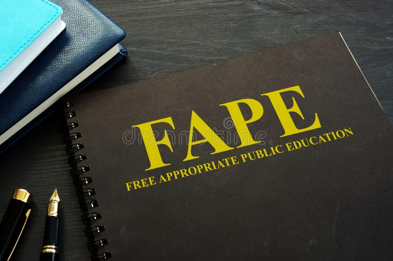 Free appropriate public education FAPE book on a desk. Free appropriate public education FAPE book on the desk royalty free stock image