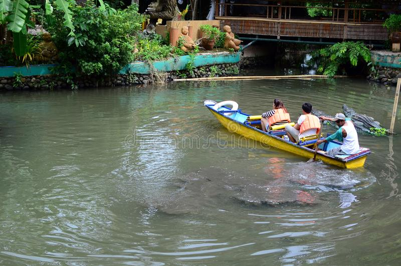 Free boat rides is offered in an Asian aquatic jungle theme park to entice tourism. Calauan Laguna, Philippines - August 28, 2016: Free boat rides is offered in royalty free stock photography