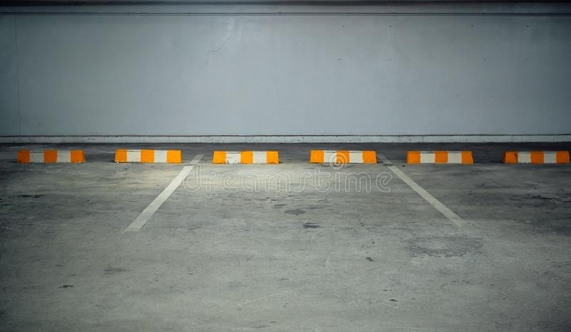Free in-building parking with yellow white barriers. stock image