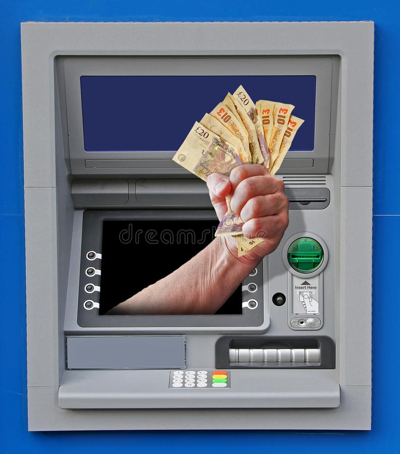 Free cash at atm till dispenser hand fist money giveaway stock photo