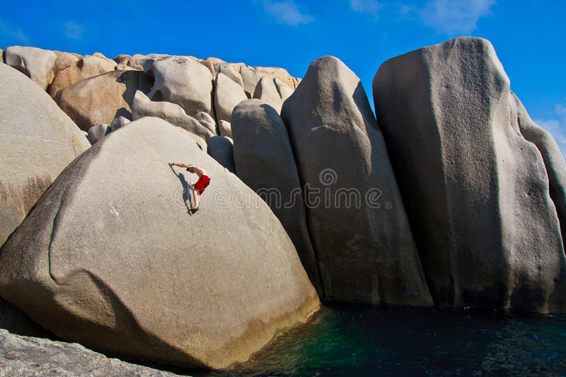 Free climber above the water stock photography