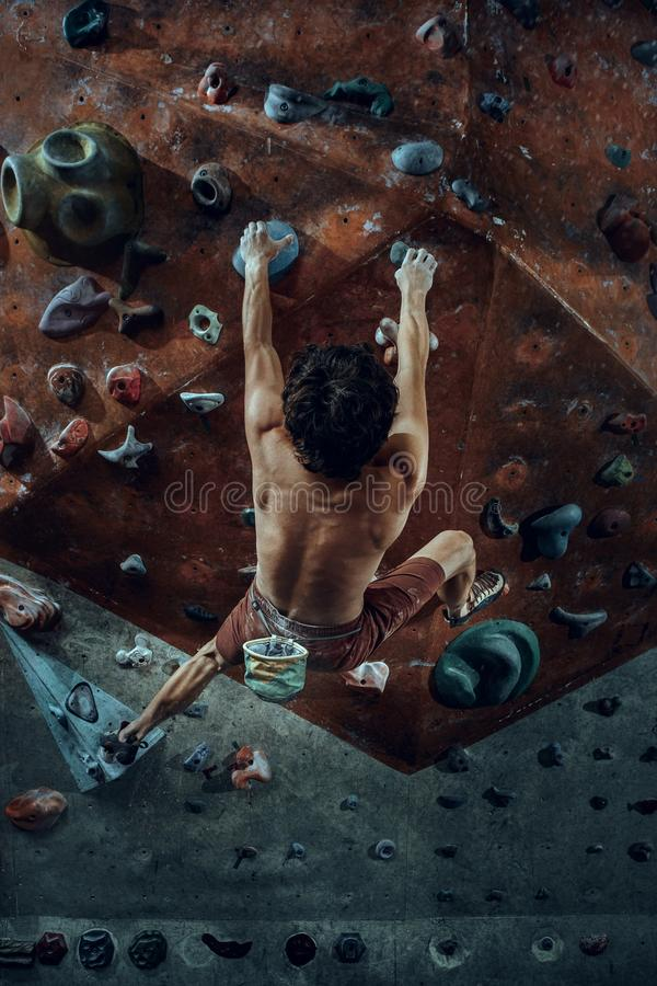 Download Free Climber Young Man Climbing Artificial Boulder Indoors Stock Photo - Image of height, hobby: 119898688