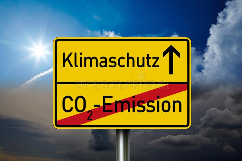 Traffic sign with the german words for climate protection and co2 emission. With sky in the background royalty free stock photo